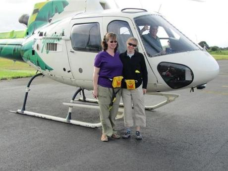Caroline Singler (left) and Allison Richardson, earth science teachers at Lincoln-Sudbury Regional High School, will present a travelogue of their trip last summer to Hawaii on Feb. 24 at 3 p.m. at Goodnow Library in Sudbury. Here they are pictured returning to Hilo from a helicopter tour over recent lava flows in the east rift zone on the outskirts of Volcanoes National Park.