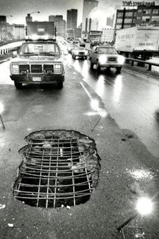 JJanuary 13, 1988: This section of the Southeast Expressway, measuring some 4 by 7 feet, collapsed leaving a hole about a foot deep. The pothole was located in the southbound side of the road some 50 yards past the Kneeland Street on-ramp in the middle lane of the road. Police said some 15 to 20 cars struck the pothole, blowing out tires and damaging front end suspensions and tie rods before the signaling flares could be placed around the hole to alert motorists.
