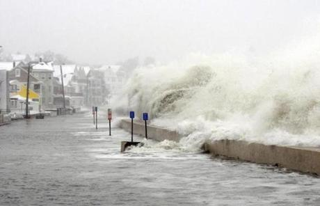 The ocean overflowed the sea wall on Winthrop Shore Drive in Winthrop.