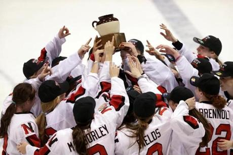 The Northeastern Huskies celebrated after defeating BC 4-3 in the women's Beanpot hockey championship game at Matthews Arena.