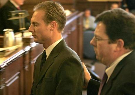Providence, RI - 02/07/06 - Providence Superior Court-Defendant Daniel Biechele, cq, at left, leaves the Providence Superior Courtroom accompanied by his lead attorney Thomas G. Briody, cq, at right, after pleading guilty to 100 counts of misdemeaner manslaughter in the Station nightclub fire. (Barry Chin/Globe Staff) section: metro, reporter: unknown, slug: unknown. Library Tag 02082006 National/Foreign Page One