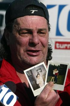 Steven Ayer held photos of his daughter Tina Ayer the day after the fire. She was later identified as one of the 100 killed.