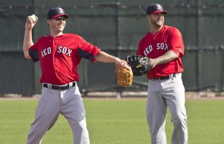 Infielders Stephen Drew (left) and Mike Napoli were on a practice field at JetBlue Park during the second day of spring training.