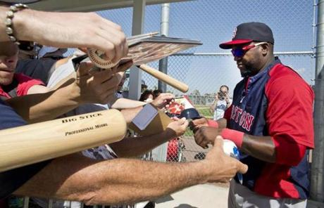 David Ortiz signed autographs for fans after Wednesday's training.