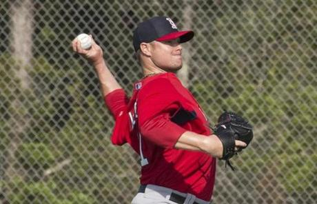 Pitcher Jon Lester threw a long toss during Wednesday's spring training.