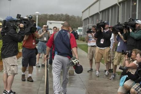 Shane Victorino walked through a crowd of media personnel as he headed to the batting cages.