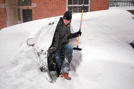 Aengus Mcallister emerged with a snow brush from his SUV on Walnut Street in Beacon Hill as people began to dig out from the blizzard.