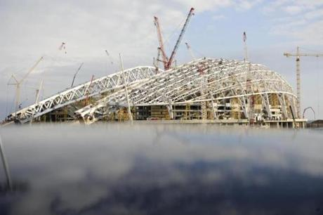 With a year still to go, construction work remained at the Olympic stadium.