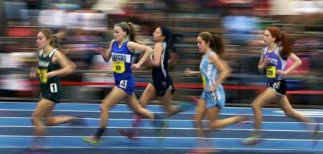 Girls ran a 1,000-meter heat in the MIAA Track and Field Division Three Championships at the Reggie Lewis Track and Athletic Center.
