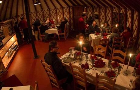 Guests dine in the Ledgewood Yurt at Killington Resort in Vermont.