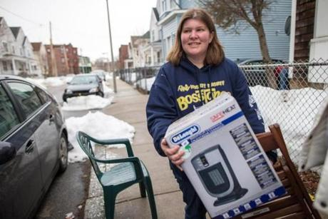 Caitlin Minnich moved to an apartment on Brook Avenue in Dorchester amid snow flurries on Saturday.