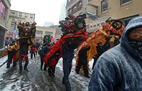 2/17/13: Boston, MA: Despite the inclement weather, Chinese New Year festivities took place this morning all over the Chinatown area of Boston. Here a Lion Dance proceeds on Tyler Street. section: metro topic: 18newyear (Jim Davis/Globe Staff)