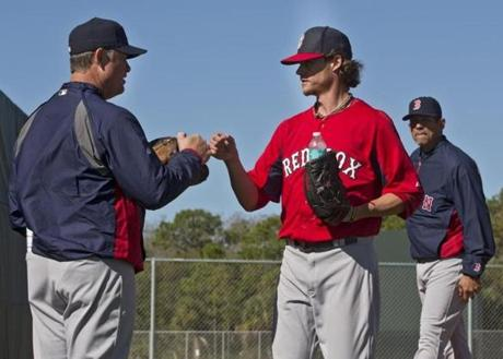 Red Sox manager John Farrell fist bumped pitcher Clay Buchholz.