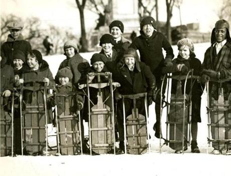 February 6, 1930: Winter provided splendid coasting on Boston Common and hundreds of youngsters turned out for sliding on the historic grounds. These coasters waited their turn for a slide on the toboggan chute.