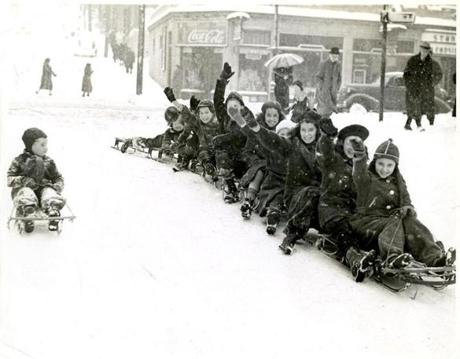 December 8, 1938: A group of enthusiastic sledders on Fenwood Road in Roxbury.