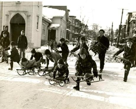 December 9, 1940: The start of a big sled race on Sewall St. in Somerville.