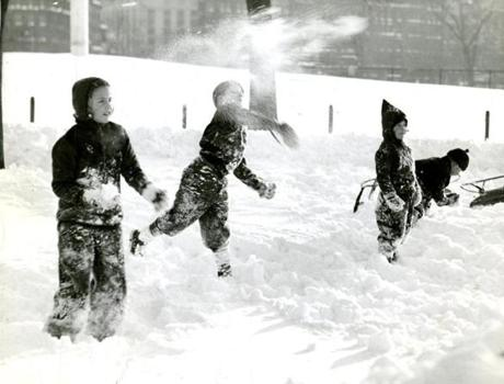January 29, 1941:  A fierce snow battle in progress at the Public Garden in Boston during a break in sledding.