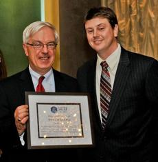 John Regan (left) received the Distinguished Service Award from Tim McLaughlin, president of Shelter Legal Services.