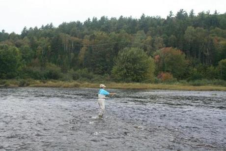 Marsha Pond fly-fishing on the Miramichi.