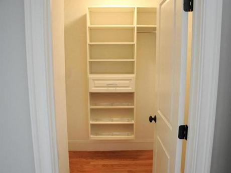 One of the closets off the master bedroom has built-in shelving and a walk-in closet with more shelving.