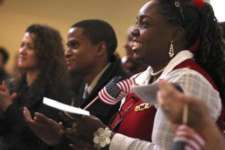 New US citizens applauded after they were sworn in during the citizenship ceremony at the Museum of African American History on Beacon Hill in Boston.