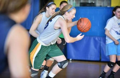 Maura Buckley, center, during practice with Arlington Catholic girls, always a contender in the Division 2 tournament.