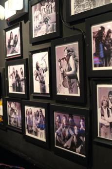 24sodine - Photos of Rock greats adorn the wall, adding a funky flair to the open space, which doubles as a dining room and dance floor. (Jessica Bartlett)