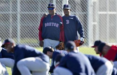 Coaching assistant Ino Guerrero, left, is one of the few faces still in uniform now who was with the team when Martinez last pitched in 2004.