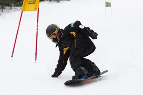 Jaden Tran Fergus, 10, of Dorchester is timed on his run down the slope.