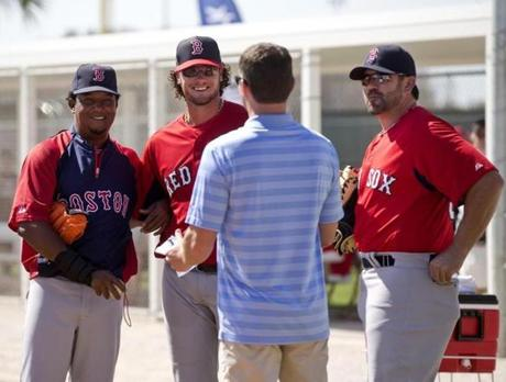 Special assistants Pedro Martinez, left, and Jason Varitek, right, joined GM Ben Cherington and catcher Jarrod Saltalamacchia for a huddle during spring training at JetBlue Park in Fort Myers, Fla.