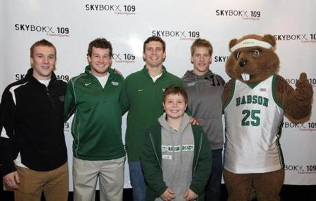 SKYBOKX 109 GastroSports in Natick recently partnered with Team IMPACT, the Quincy-based nonprofit organization that matches children facing life-threatening illnesses with college athletic teams in the New England, Tri-state, Mid-Atlantic, and Midwest regions. From left to right: Babson College men's hockey teammates Trevor Hughes, Tom Callahan, Matt Leer, Andrew Bonazza, and mascot Biz E Beaver with Timothy Dowd, their Team IMPACT match from Framingham.