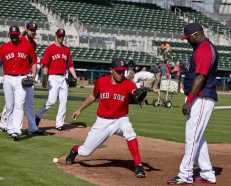 Alfredo Aceves took fielding tips from David Ortiz.