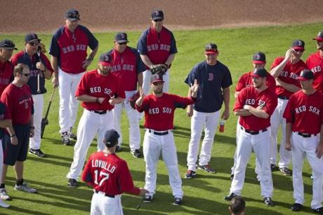 Dustin Pedroia was the center of attention with his teammates on the outfield grass.