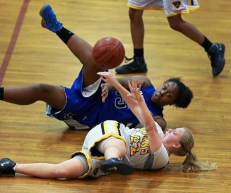 O'Bryant's Kiana Daley (top) and New Mission's Bianca Rice battled for a loose ball. O'Bryant and New Mission met in the Boston City League Championship Game at Madison Park High School.