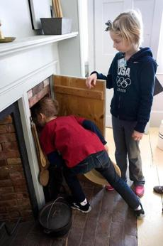 Charlie Rainville, 7, (left) checked out an old fashioned fireplace. At right is his sister sophie Rainville (9).