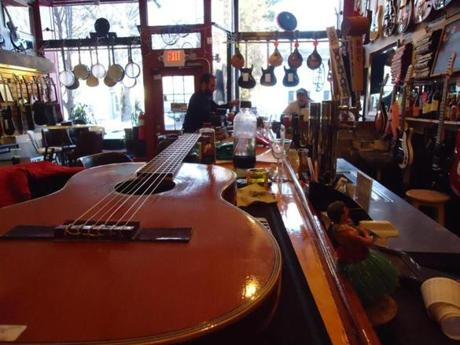 tank away - Luthiers Co-op is a guitar shop by day and music hall by night with stellar craft beers. (Kathleen Pierce)