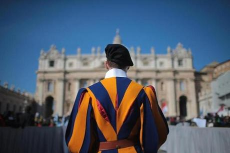 A member of the Swiss guard stood in front of the Vatican.