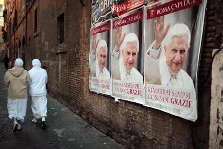 Posters of Pope Benedict hung in Vatican City.