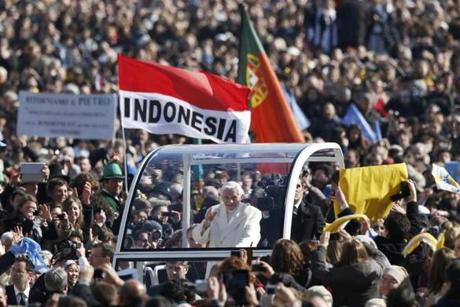 Pope Benedict XVI waved to the faithful as he arrived in St Peter's Square.