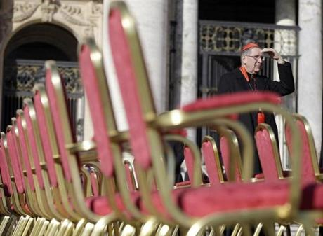 Cardinal Roger Mahoney stood next to a row of chairs in St. Peter's Square.