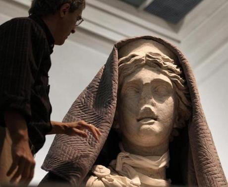 """Juno,"" covered in cloth, before her conservation work."
