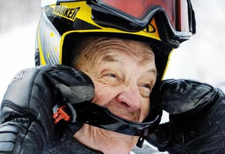 John Kielty, 84, shown after racing Saturday, recalled that his first pair of hickory skis were strapped to his street shoes.