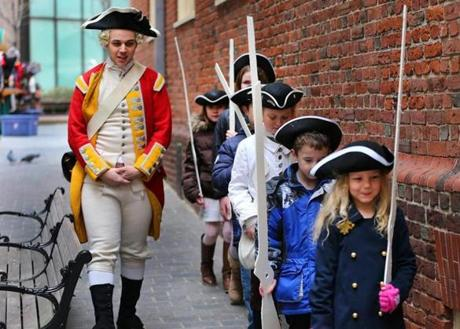 Boston-03/02/13- British corporal Daud Alyzer(cq) drills children who were recruited to play British Soldiers. March 5 is the 243rd anniversary of the Boston Massacre, so to commemorate the historic event which happened in front of the Old State House, the Bostonian Society, which runs the Old State House held a massacre re-enactment for children, who played the parts of the British soldiers and the Bostonians. Globe staff photo by John Tlumacki (metro)