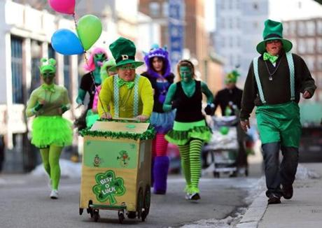 Boston-03/02/13- Participants dressed in a St. Patricks Day garb headed down Landsdowne in the Boston Urban Iditarod race in which participants race a 3.5 mile course near Fenway Park wearing costumes and pushing or pulling carts as a group. Globe staff photo by John Tlumacki (metro)