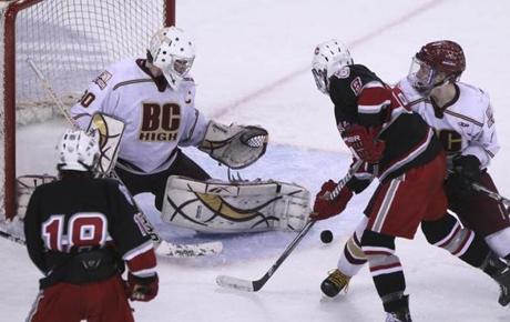 BC High goalie Peter Cronin came up big all day, including this doorstop save on Catholic Memorial's Kevin Hock.