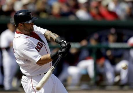 Boston Red Sox's Mike Napoli swings to hit a home run in the second inning of an exhibition spring training baseball game against the New York Yankees, Sunday, March 3, 2013, in Fort Myers, Fla. (AP Photo/David Goldman)