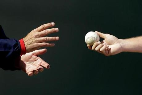 Boston Red Sox pitcher Joel Hanrahan, right, hands the ball to manager John Farrell as he is relieved from the mound in the sixth inning of an exhibition spring training baseball game against the New York Yankees, Sunday, March 3, 2013, in Fort Myers, Fla. (AP Photo/David Goldman)