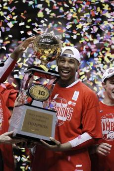 Ohio State forward Jared Sullinger smiles as he carries the trophy following a 71-60 win over Penn State in an NCAA college basketball game in the championship of the Big Ten Conference tournament in Indianapolis, Sunday, March 13, 2011. (AP Photo/Michael Conroy)
