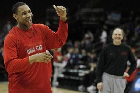 Ohio State forward Jared Sullinger, left, laughs after head coach Thad Matta broke his concentration during a free throw during practice for an East regional semifinal game in the NCAA college basketball tournament, Thursday, March 24, 2011, in Newark, N.J. Ohio State will play Kentucky on Friday. (AP Photo/Julio Cortez)