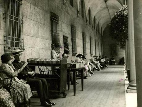 July 15, 1926: Miss Margaret Lappen of the library staff oversaw the outdoor library in the courtyard of the Boston Public Library on this summer day. From 12-2 the colonnaded courtyard was transformed into an open-air reading room. Armchairs from the main reading room as well as a book truck with over 100 books and magazines were provided for patrons to enjoy some reading time outdoors as well as the ability to check out books to take home.